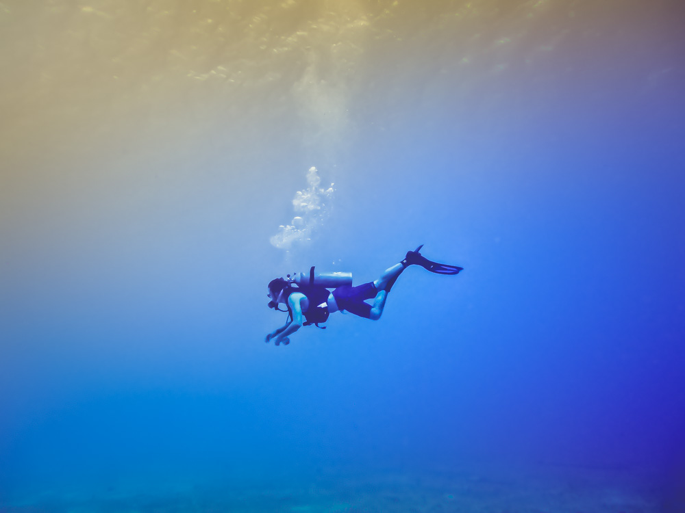 Diver In Empty Blue Space
