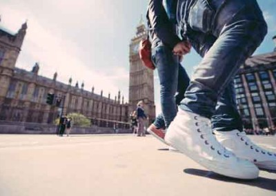 Shoes of Couple Holding Hands In London Near Big Ben
