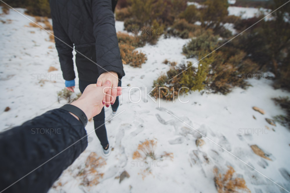 Free stock Photos- Hiking And Holding Hands in Winter Snow