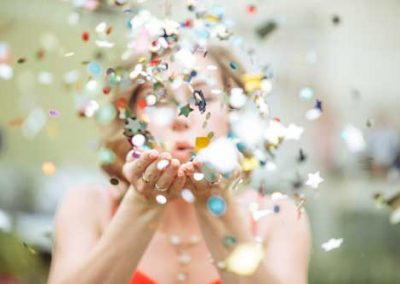 Girl Blowing Confetti